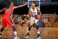 25 February 2012:  FIU guard Jerica Coley (22) handles the ball while being defended by South Alabama guard Mansa El (33) in the second half as the FIU Golden Panthers defeated the University of South Alabama Jaguars, 58-55 (OT), at the U.S. Century Bank Arena in Miami, Florida.  Coley scored 25 points, and is currently the third leading scorer in NCAA Division I basketball.
