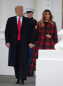 United States President Donald J. Trump and First lady Melania Trump walk out of the North Portico to accept the White House Christmas tree on the North Driveway of the White House in Washington, DC on Monday, November 19, 2018. The 2018 White House Christmas Tree will arrive as in previous years by horse and carriage on the North Portico. The tree will be displayed in the Blue Room of the White House. <br /> Credit: Ron Sachs / CNP<br /> (RESTRICTION: NO New York or New Jersey Newspapers or newspapers within a 75 mile radius of New York City)