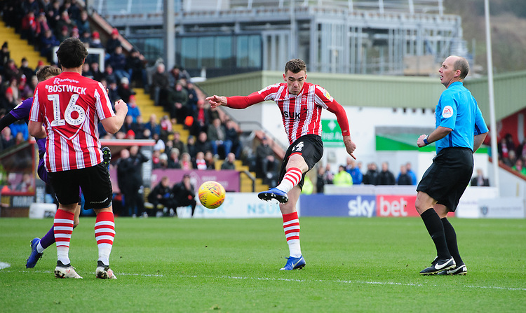 Lincoln City's Harry Toffolo scores the opening goal<br /> <br /> Photographer Chris Vaughan/CameraSport<br /> <br /> The EFL Sky Bet League Two - Lincoln City v Grimsby Town - Saturday 19 January 2019 - Sincil Bank - Lincoln<br /> <br /> World Copyright &copy; 2019 CameraSport. All rights reserved. 43 Linden Ave. Countesthorpe. Leicester. England. LE8 5PG - Tel: +44 (0) 116 277 4147 - admin@camerasport.com - www.camerasport.com