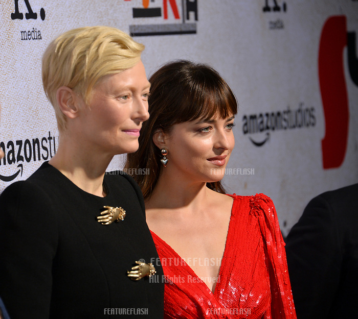 LOS ANGELES, CA. October 24, 2018: Tilda Swinton &amp; Dakota Johnson at the Los Angeles premiere for &quot;Suspiria&quot; at the Cinerama Dome.<br /> Picture: Paul Smith/Featureflash