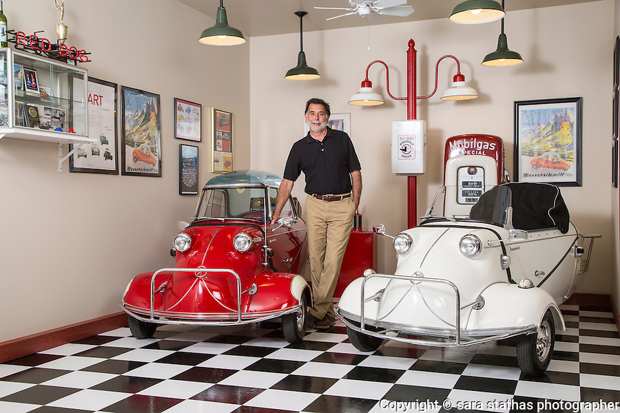 Jim Garbo stands with his 1955 Messerschmitt KR 200 (red) and 1957 Messerschmitt KR 201 (white) inside of his garage workshop in Franksville, Wisconsin.