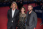 (From L) US producer Hunter Gray, French and Spanish actress Astrid Berges-Frisbey and US director Mike Cahill pose on the red carpet as they arrive for the  'The November man' premiere during the 40th Deauville American Film Festival on September 5, 2014 in Deauville,