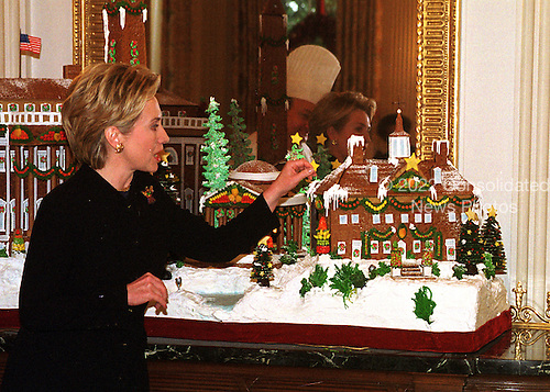 "First Lady Hillary Rodham Clinton announced the 1999 White House holiday theme ""Holiday Treasures at the White House"" at the White House in Washington, D.C. on December 6, 1999.  The traditional Gingerbread creation, located in the State Dining Room, is a confectionery tribute to some of the historic treasures around our nation's capitol.  White House pastry chefs created this delicious masterpiece to take us back to 19th century Washington, surrounded by four timeless landmarks at Christmas time: The White House, the Jefferson Memorial, the Washington Monument, and Mount Vernon.  The spectacular creation would not be complete without its marzipan Potomac River and the chocolate trees that line its banks.  .Credit: Ron Sachs / CNP"