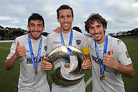 From left, Auckland City FC's Emiliano Tade, captain Angel Berlanga and Albert Riera with the trophy after the Oceania Football Championship final (second leg) football match between Team Wellington and Auckland City FC at David Farrington Park in Wellington, New Zealand on Sunday, 7 May 2017. Photo: Dave Lintott / lintottphoto.co.nz