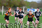 GAA sandwich<br /> --------------------<br /> Ardferts Brendan Barrett races between two rocks,Shane O'Callaghan (LT) and Barry Walsh(RT) when the teams played in Ardfert last Saturday evening