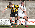 East Fife's Marc McKenzie holds off Ayr Utd's Michael McGowan.