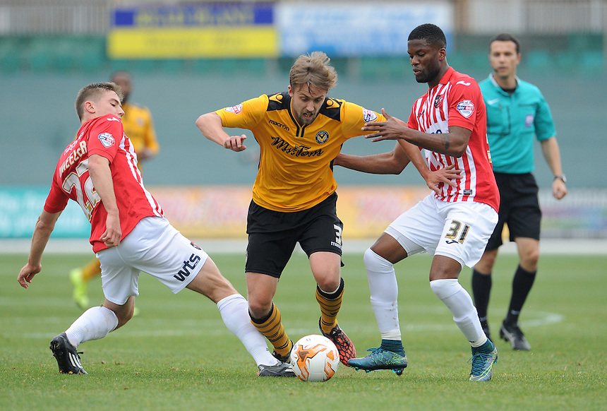 Newport County's Scott Barrow battles with Exeter City's David Wheeler and Joel Grant<br /> <br /> Photographer  Ian Cook/CameraSport<br /> <br /> Football - The Football League Sky Bet League Two - Newport County AFC v Exeter City - Saturday 3rd October 2015 - Rodney Parade - Newport<br /> <br /> &copy; CameraSport - 43 Linden Ave. Countesthorpe. Leicester. England. LE8 5PG - Tel: +44 (0) 116 277 4147 - admin@camerasport.com - www.camerasport.com