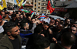 Mourners carry the bodies of two Palestinians Zead Al-Nori and Raed Hamdan, during their funeral in the West Bank on Nablus, on March 20, 2019. Israeli forces killed three Palestinians in two separate incidents on Tuesday night, Palestinian health ministry and emergency services said. Photo by Shadi Jarar'ah