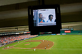 United States President George W. Bush and U.S. Secretary of State Condoleezza Rice can be seen on the stadium's televisions during the baseball game between the Washington Nationals and San Diego Padres  at RFK Stadium on July 8, 2006.  They were joined by First Lady Laura Bush,  Condoleezza Rice and U.S. Attorney General Alberto Gonzales.<br /> Credit: Jay L. Clendenin - Pool via CNP