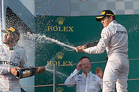 March 20, 2016: Lewis Hamilton (GBR) #44 and Nico Rosberg (DEU) #6 from the Mercedes AMG Petronas team celebrate coming second and first respectively at the 2016 Australian Formula One Grand Prix at Albert Park, Melbourne, Australia. Photo Sydney Low