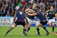 Schalk Burger of South Africa takes on the USA defence. Rugby World Cup Pool B match between South Africa and the USA on October 7, 2015 at The Stadium, Queen Elizabeth Olympic Park in London, England. Photo by: Patrick Khachfe / Onside Images