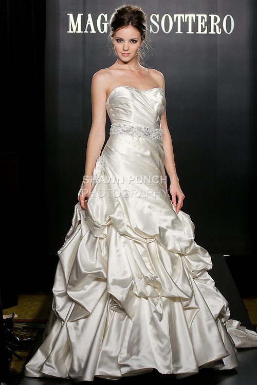 Model walks the runway in a Kennedy wedding dress from the Sottero and Midgley Spring 2012 collection, during  Couture: New York Bridal Fashion Week 2012