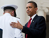 Arlington, VA - May 25, 2009 -- United States President Barack Obama greets Admiral Michael Mullen, left, Chairman of the Joint Chiefs of Staff, during Memorial Day Ceremonies at Arlington National Cemetery in Arlington, VA, U.S.,  Monday, May 25, 2009.  .Credit: Joshua Roberts - Pool via CNP