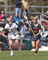University of Maryland midfielder/defender Jen Mendez (25) on the attack as Boston College midfielder Mikaela Rix (17) defends..University of Maryland (black) defeated Boston College (white), 13-5, on the Newton Campus Lacrosse Field at Boston College, on March 16, 2013.