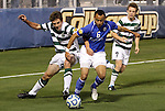 09 December 2011: Creighton's Dion Acoff (6) is defended by UNCC's Thomas Allen (5) and Owen Darby (7). The Creighton University Bluejays played the University of North Carolina Charlotte 49ers to a 0-0 overtime tie, the 49ers won the penalty shootout 4-1 to advance at Regions Park in Hoover, Alabama in an NCAA Division I Men's Soccer College Cup semifinal game.