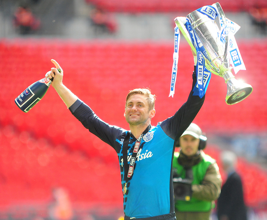 Queens Park Rangers' Robert Green celebrates with the Play-Off trophy<br /> <br /> Photographer Chris Vaughan/CameraSport<br /> <br /> Football - The Football League Sky Bet Championship Play-Off Final - Derby County v Queens Park Rangers - Saturday 24th May 2014 - Wembley Stadium - London<br /> <br /> &copy; CameraSport - 43 Linden Ave. Countesthorpe. Leicester. England. LE8 5PG - Tel: +44 (0) 116 277 4147 - admin@camerasport.com - www.camerasport.com