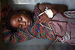 Kanké, 10, recovers from cholera at Donka Cholera Treatment Center in Conakry, Guinea, Aug. 18, 2012. Médecins Sans Frontières is responding to a cholera outbreak in Guinea, which is affecting coastal areas and inland. Two emergency MSF cholera treatment centers in Conakry are receiving around 60 new cases per day, and a third treatment center opened over the weekend.