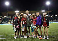 Portland, Oregon - Wednesday September 7, 2016: Portland Thorns FC midfielder Tobin Heath (17) poses with young fans after a regular season National Women's Soccer League (NWSL) match at Providence Park.