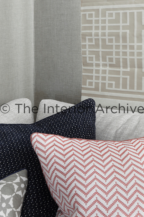 Detail of a variety of patterned and textured cushions on one of the sofas