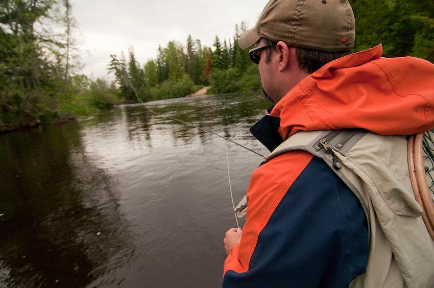 A fly fisherman on the Escanaba River near Gwinn Michigan.