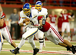 VERMILLION, SD - NOVEMBER 18: Taryn Christion #3 from South Dakota State University tries to slip the grasp of Nathan Schultz #96 from the University of South Dakota during their game Saturday afternoon at the DakotaDome in Vermillion. (Photo by Dave Eggen/Inertia)