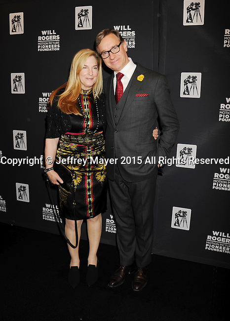 LAS VEGAS, NV - April 22: Director Paul Feig (R) and wife Laurie Karon attend the Pioneer Dinner during 2015 CinemaCon at Caesars Palace on April 22, 2015 in Las Vegas, Nevada.