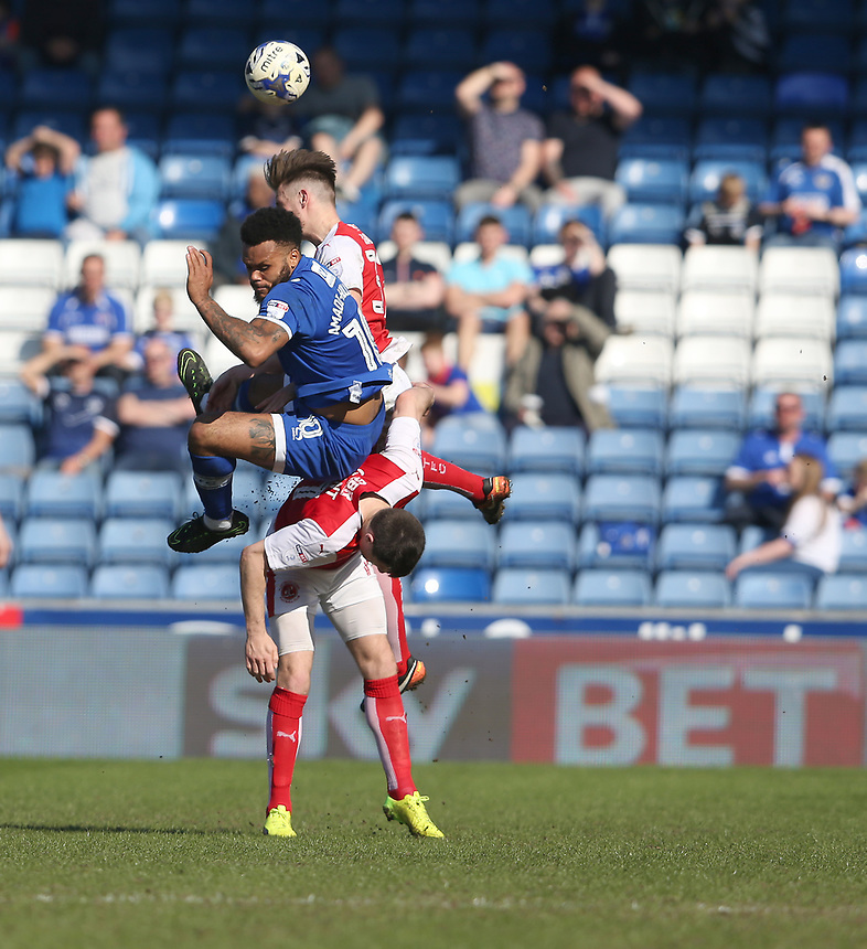 Oldham Athletic's Aaron Holloway battles with Fleetwood Town's Bobby Grant and Ben Davies<br /> <br /> Photographer Stephen White/CameraSport<br /> <br /> The EFL Sky Bet League One - Oldham Athletic v Fleetwood Town - Saturday 8th April 2017 - SportsDirect.com Park - Oldham<br /> <br /> World Copyright &copy; 2017 CameraSport. All rights reserved. 43 Linden Ave. Countesthorpe. Leicester. England. LE8 5PG - Tel: +44 (0) 116 277 4147 - admin@camerasport.com - www.camerasport.com