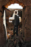 Mr Bakhid abdulgharim Abkar stands in fron of his destryed home in the village of Forauya in north darfur on Nov 2004. the genocide began two years ago, since then hundreds of thousands of innocent darfurians were killed and millions have been displaced. athough 200.000 floded into Chad and found help from the international community, the majority still lives in fear in the inner borders in drammatic conditions.