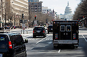 United States President Barack Obama's motorcade heads towards the U.S. Capitol as the President continues a series of meetings with Republican and Democratic leaders in an effort to reach budget compromise in Washington, D.C. on March 14, 2013. .Credit: Kristoffer Tripplaar / Pool via CNP