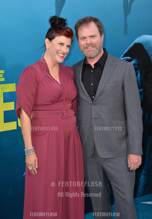 """LOS ANGELES, CA - August 06, 2018: Rainn Wilson & Holiday Reinhorn at the US premiere of """"The Meg"""" at the TCL Chinese Theatre"""