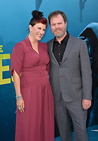 "LOS ANGELES, CA - August 06, 2018: Rainn Wilson & Holiday Reinhorn at the US premiere of ""The Meg"" at the TCL Chinese Theatre"