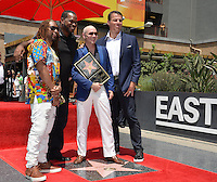 LOS ANGELES, CA. July 15, 2016: Singer Pitbull (Armando Christian Perez) with Lil Jon, Luther Campbell &amp; motivational speaker Tony Robbins on Hollywood Blvd where Pitbull was honored with the 2,584th star on the Hollywood Walk of Fame.<br /> Picture: Paul Smith / Featureflash