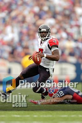 25 September 2005: Michael Vick (7), Quarterback for the Atlanta Falcons, scrambles for first down yardage in a game against the Buffalo Bills. The Falcons defeated the Bills 24-16 at Ralph Wilson Stadium in Orchard Park, NY.<br />