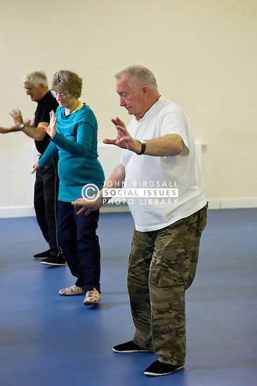 People enjoy socialising and activity at a council run over 50's club in Basildon, Essex. A Tai Chi class *Model Released*
