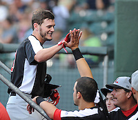 Left fielder Trever Adams (30) of the Hickory Crawdads is congratulated after hitting a home run in a game against the Greenville Drive on Sunday, September 2, 2012, at Fluor Field at the West End in Greenville, South Carolina. Hickory won, 8-4. (Tom Priddy/Four Seam Images)