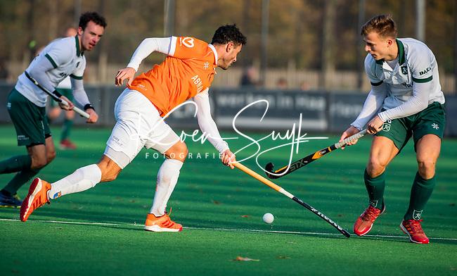 BLOEMENDAAL - Glenn Schuurman (Bldaal) met Thijs van Dam (R'dam) tijdens  hoofdklasse competitiewedstrijd  heren , Bloemendaal-Rotterdam (1-1) .COPYRIGHT KOEN SUYK