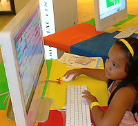 Introducing Children  to Art using Apple Computers at ROCKWELL Shopping Center during a week long  Summer  Kiddie Workshop in Manila, Philippines. Sponsored by the Power Mac Center.