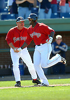 Portland Sea Dogs' manager Arnie Beyler congratulates Boston Red Sox' OF Mike Cameron, in town on a rehab assignment, as he rounds third after hitting a walk-off HR during a game vs. the Trenton Thunder at Hadlock Field May 23, 2010 in Portland, ME (Photo by Ken Babbitt/Four Seam Images)