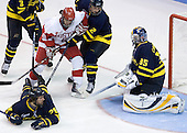 Joe Pereira (BU - 6) is surrounded by 4 Merrimack players - Jeff Velleca (Merrimack - 28), Kyle Bigos (Merrimack - 3), Fraser Allan (Merrimack - 2) and Joe Cannata (Merrimack - 35) none of whom appear to see the puck. - The Boston University Terriers defeated the Merrimack College Warriors 6-4 on Saturday, November 14, 2009, at Agganis Arena in Boston, Massachusetts.