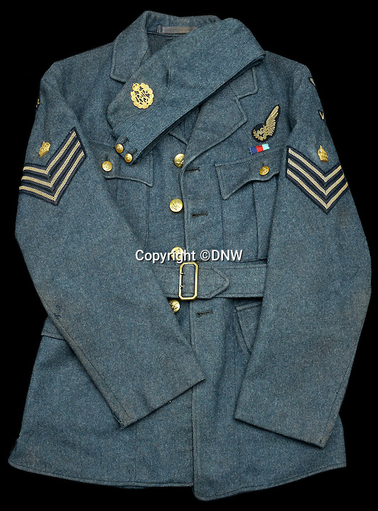 BNPS.co.uk (01202 558833)<br /> Pic: DNW/BNPS<br /> <br /> Flt Sgt Stephen Burns dress suit - Sarah Burns slept with it after his death.<br /> <br /> An incredibly poignant poem left by a grieving mother in her war hero son's flying log book has been uncovered to reveal the devastation his death had on her.<br /> <br /> Sarah Burns was so heartbroken at the loss of son Stephen - who flew on the famous Dambusters Raid - that she slept with his spare RAF uniform for solace.<br /> <br /> She also penned a touching poem in his logbook alongside the signatures of RAF legends Guy Gibson and Sir Leonard Cheshire. The items are now being sold by Dix Noonan Webb.
