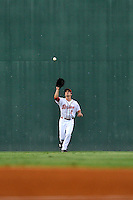Center fielder Andrew Benintendi (2) of the Greenville Drive tracks a fly ball in a game against the Greensboro Grasshoppers on Tuesday, August 25, 2015, at Fluor Field at the West End in Greenville, South Carolina. Benintendi is a first-round pick of the Boston Red Sox in the 2015 First-Year Player Draft out of the University of Arkansas. Greensboro won, 3-2. (Tom Priddy/Four Seam Images)