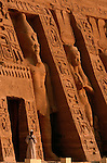 Detail of fascade of small temple, Abu Simbel, Egypt, Large statues of Kings & Queens flanked by smaller statues of children, dedicated to Nefertari, Ramses II wife, and goddess Hathor, New Kingdom.