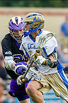 Los Angeles, CA 02/15/14 - Nolan Werner (UCLA #28) and Devin McDermott (Washington #25) in action during the Washington versus UCLA  game as part of the 2014 Pac-12 Shootout at UCLA.  UCLA defeated Washington 13-7.