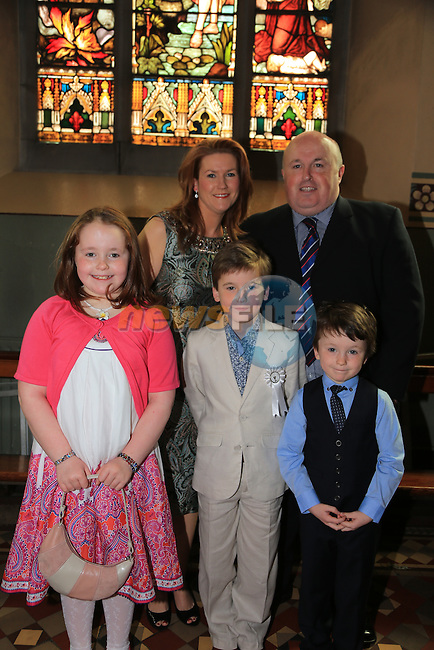 Conor Lumsden who made his first communion in St Marys church Eoin Caoimhe Sherlie and Joe..Picture: Fran Caffrey / www.newsfile.ie ..