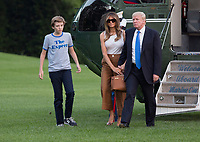 United States President Donald J. Trump, First Lady Melania Trump and their son Barron Trump return to the White House in Washington, DC, after a trip to New Jersey, June 11, 2017. Photo Credit: Chris Kleponis/CNP/AdMedia