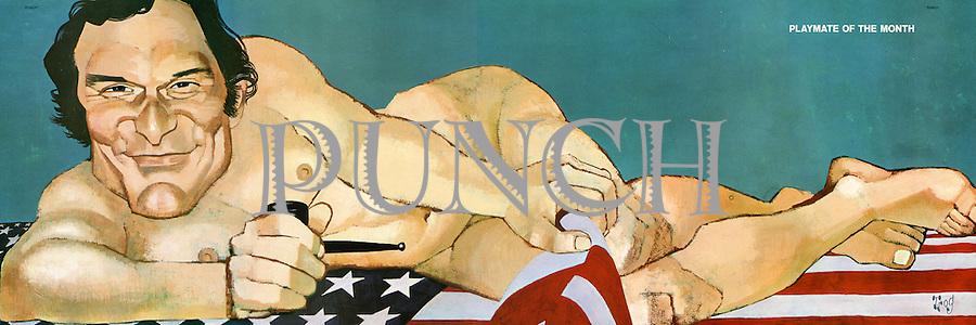 (Hugh Hefner posing on an American flag)
