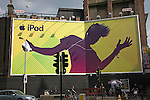 Huge bill board advertising poster for Apple iPod in central London, England