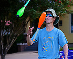 Street juggler at Round Rock Chalk Art Festival in Round Rock Texas