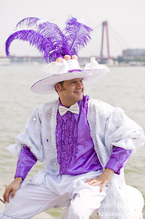 A man relaxs before the start of the parade for the ZomerCarnaval (Summer Carnival) in Rotterdam, the Netherlands. The street parade is the colorful high point of the Rotterdam carnival. It is a tropical themed parade with over 2000 participants and travels 6km through the center of Rotterdam.