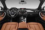 Stock photo of straight dashboard view of 2017 BMW 3-Series 330i-Sports-Wagon 5 Door Wagon Dashboard